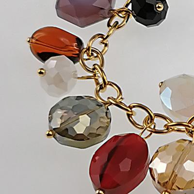 Conjunto de acero quirúrgico 316 Brilho Steel con colgantes dorados y piedras naturales detalle 2