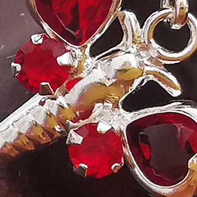 Juego de plata mariposa con microcircones rojos detalle 2