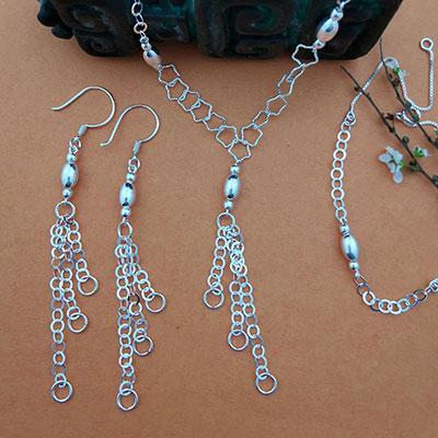 Conjunto aros, collar y pulsera de plata