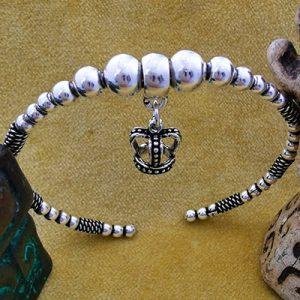 Pulsera de plata brazalete con colgante de corona