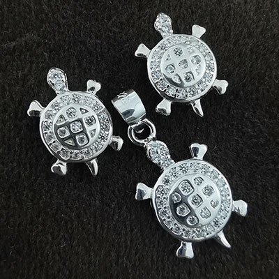 Conjunto aros y colgante tortugas de plata