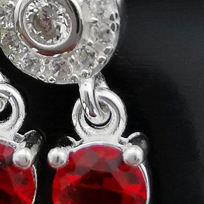 Aros de plata circones rojos detalle