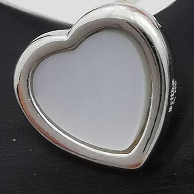 Aros de plata corazones con piedra nacar detalle