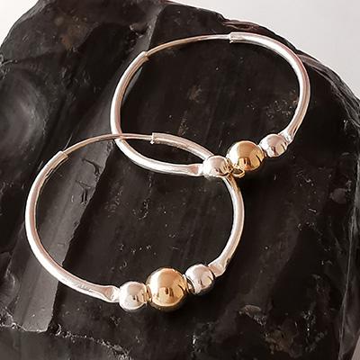 Aros de plata con esferas de enchape dorado