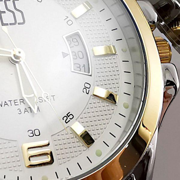 Reloj Yess metálico dos tonos detalle