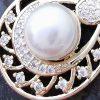 Conjunto enchapado con perla y microcircón detalle